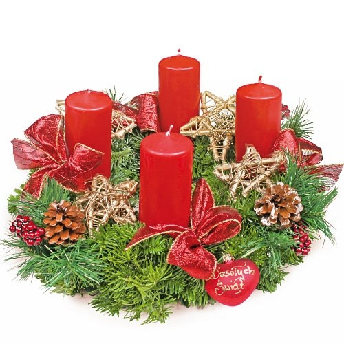 Advent centrepiece,coronet made of fir , candles, stars, ribbons and Christmas decorations