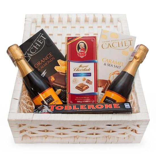 sparkling wine set, 2 bottles of sparkling wine, 3 bars of chocolate, toblerone bar, white wicker basket with lid