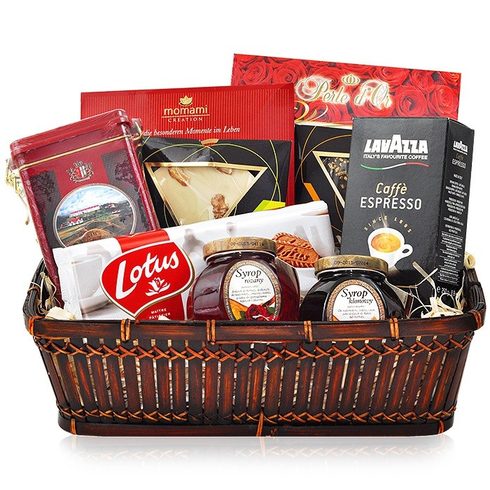 basket elegance, scottish breakfast tea, ground espresso, pralines exelcium, cookies in belgian chocolate, white chocolate with nuts, sweets in a brown wicker basket