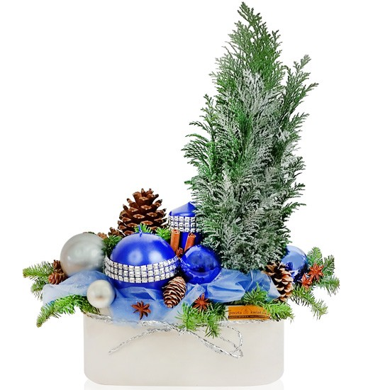 Centrepiece Haberdashery, cypress, cones, fir branches, cinnamon, candles, organza baubles in a ceramic pot, holiday reeds