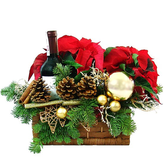 Warming centrepiece, poinsettia, cinnamon, cones, fir branches, candles, baubles, rosehip, wine in a box, reeds as a gift