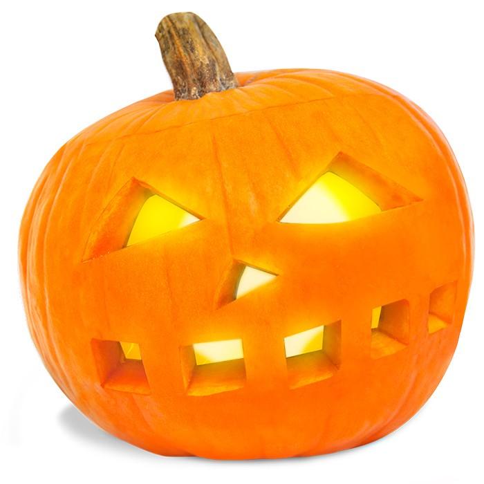 Dynia, wydrążona dynia z wyciętym upiornym uśmiechem ze świeczką, Halloween