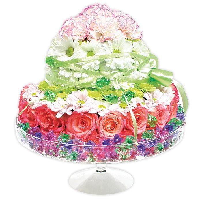 kompozycja aromatyczny tort, kompozycja kwiatów, róże, margaretki, santini, goździki, kolorowe kryształki, kompozycja na szklanej paterze ułożone w kształcie tortu