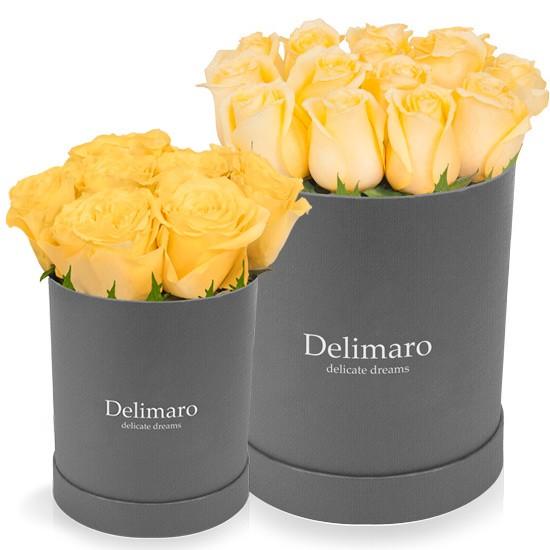 Żółte róże w szarym pudełku, róże w pudełku, szare pudełko okrągłe