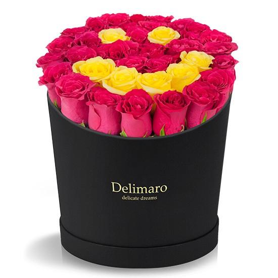 Uśmiech z róż w czarnym pudełku, czerwone róże, żółte róże w czarnym pudełku