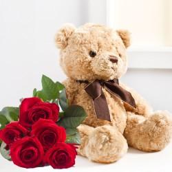 Siedem czerwonych róż i pluszowy miś