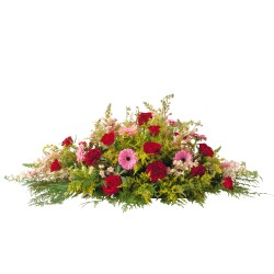 Orange and red funeral spray