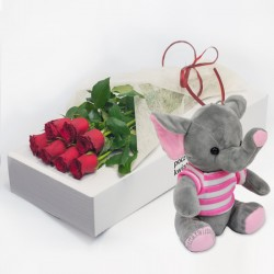 7 red roses with pink elephant