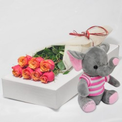 7 tea roses with pink elephant