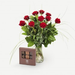 Romantic red roses with chocolates