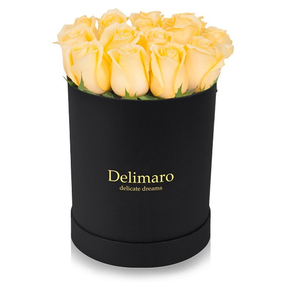 Yellow roses in a black box