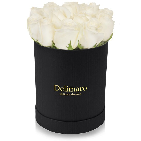 White roses in a black box